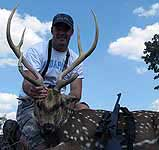 Trophy Axis Buck Hunts in the rolling his with cactus