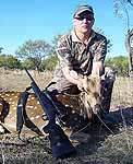 hunting axis in the rocky hills of texas