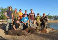 friends and family hunt for wild hogs by water in hill country