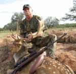 fallow buck spotted rifle rocks hunt